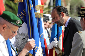 French Prime Minister Edouard Philippe talks to a veteran in Nice