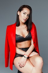 young woman in jacket and lingerie