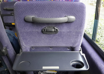 Bus tray table on seat back