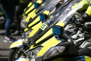 A group police motorbikes parked in a line in London