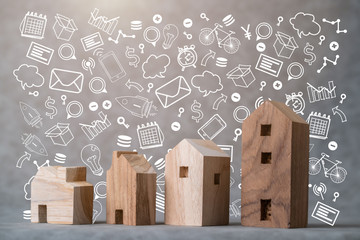many toy wooden house block on grey leather background with business icon communication ideas concept