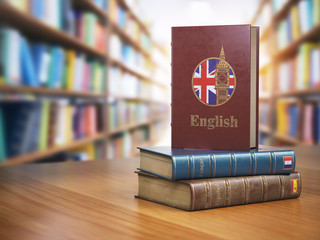 Learn English concept. English dictionary book or textbok with flag of Great Britain and Big ben tower on the cove in the library.