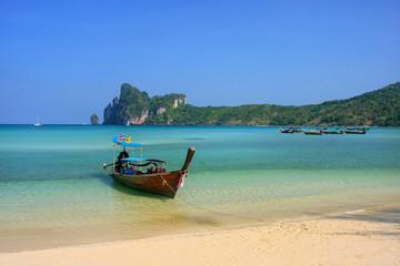 Longtail boat anchored at Ao Loh Dalum beach on Phi Phi Don Island, Krabi Province, Thailand