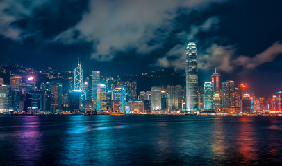 Futuristic City Skyline at Night with Colourful Lights and Reflections, Hong Kong