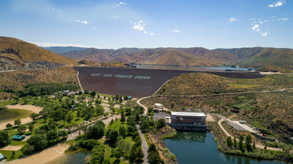 Aerial view of Luck Peak Dam on the Boise River Idaho with a park filled with trees
