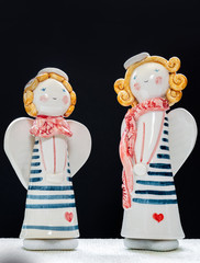 Figurine Of Two Cute Angels On Black Background 1