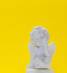 Figurine Of Baby Angel On Yellow Background 1