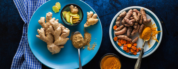 banner of roots of ginger and turmeric and powder of them. healthy natural supplements, spices for cooking