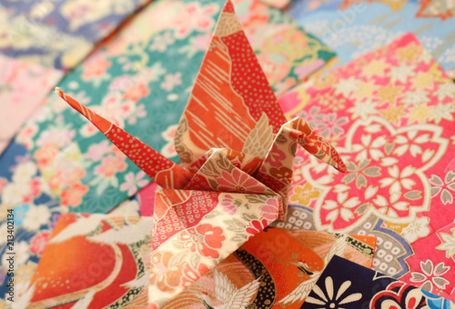 Close Up Of A Colorful Japanese Origami Paper Crane On A Stack Of Impressive Patterned Origami Paper
