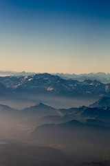 Alps mountains from range aerial view at sunrise. Switzerland. Filtered image:cross processed vintage effect.