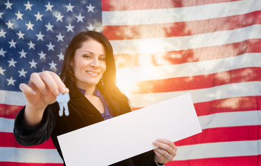 Hispanic Woman House Keys and Blank Sign In Front of American Flag