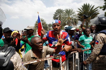 Demonstrators chant slogans in front of the Parliament during a protest in Port-au-Prince