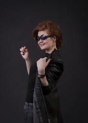 Emotional brunette posing in the Studio in a leather cloak.