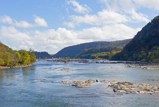 Bridge over Shenandoah River in Harpers Ferry, West Virginia, USA. Blue Ridge Mountain in Harpers Ferry National Historical Park in autumn.