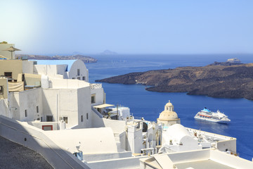 Thira town cityscape during daytime in Santorini, Greece with cruise ship on sea