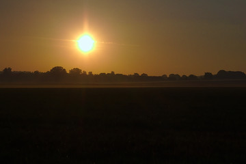 Sunrise in agriculture landscape
