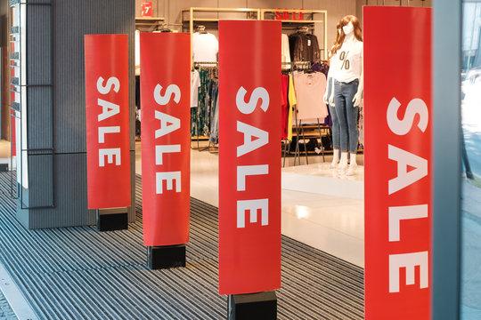 "Sale - shop entrance / storefront with ""Sale"" banner"