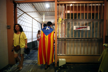 "Catalan separatist supporter walks by former penitentiary ""La Model"" after a protest against the imprisonment of the Catalan separatist leaders in Barcelona"