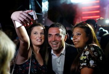 Macedonian Foreign Minister Nikola Dimitrov takes a selfie with supporters during events organized by the government in 15 towns to celebrate an invitation for Macedonia to join NATO, in Skopje