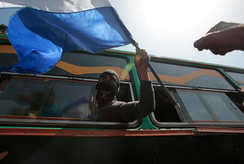 University students wave flag and shout slogans during their arrival at the Metropolitan Cathedral in Managua