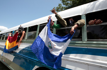 University students shout slogans during their arrival at the Metropolitan Cathedral in Managua