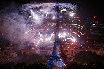 Fireworks explode near the Eiffel Tower, in a picture taken from the Montparnasse Tower Observation Deck, at the end of Bastille Day events in Paris