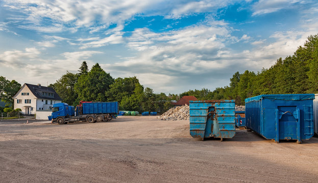 Recycling yard with trucks and different containers