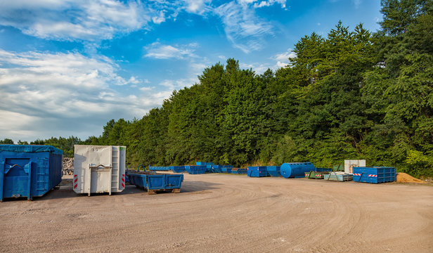 Recycling yard with different containers.