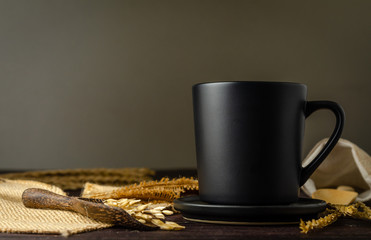 coffee in a black mug with dark background