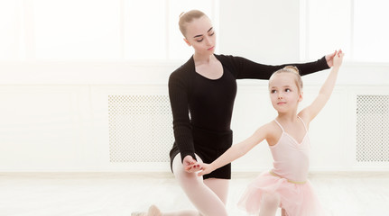 Little girl looking at professional ballet dancer