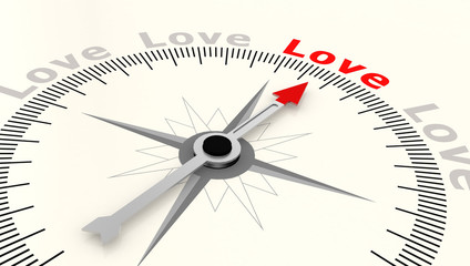Compass with arrow pointing to the word love