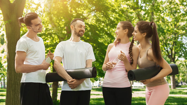 Group of people talking after exercising at park