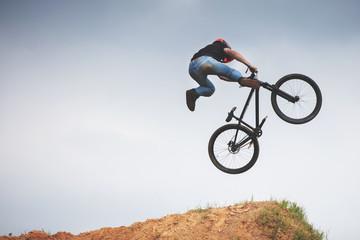 mtb dirt rider doing trick on a jump