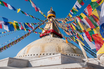 prayer flags over boudhanath stupa in kathmandu