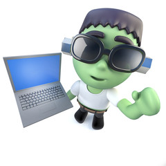 3d Funny cartoon frankenstein monster holding a laptop computer