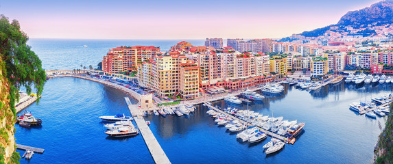 Monaco, Europe. Panoramic scenic view on fashionable apartment district and port Fontvieille in Monaco - small country, symbol of wealth and richness. Beautiful evening skyline of Monaco.