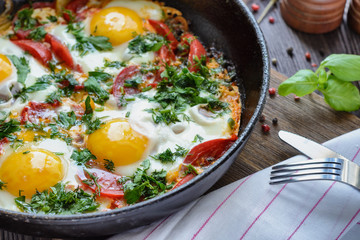 Freshly cooked fried eggs in a frying pan for breakfast