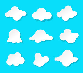 Set of cartoon clouds isolated on a blue background. paper art vector illustration.