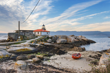 Lighthouse and fishing boat