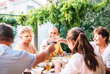 Family dinner in summer garden