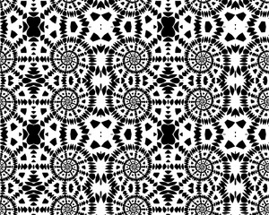 Seamless decorative pattern with spirals in a black and white colors