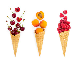 Set of assorted berries and fruit in waffle ice cream cone. Concept of healthy eating.