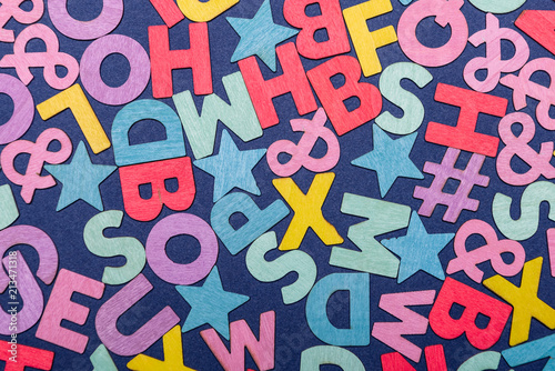 Background of mixed colorful English alphabets
