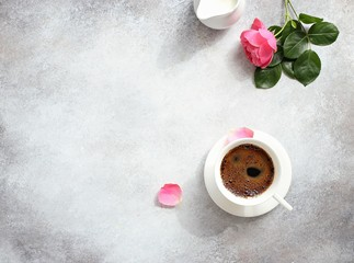 Coffee. Happy morning with cup of coffee and pink rose. Overhead view, copy space.