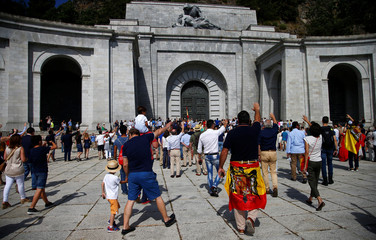 People attend a demonstration against plans to remove Franco from the Valle de los Caidos in San Lorenzo de El Escorial