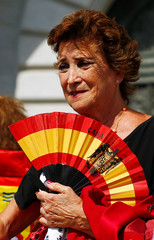 A woman attends a demonstration against plans to remove Franco from the Valle de los Caidos in San Lorenzo de El Escorial