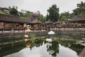 Bali, Indonesia: Panoramic view of building on lake shore with reflection in water