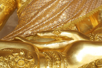 Golden hand of image Buddha close up.
