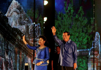 Cambodia's PMr Hun Sen and his wife Bun Rany greet people during templates as UNESCO World Heritage Sites anniversaries in Phnom Penh