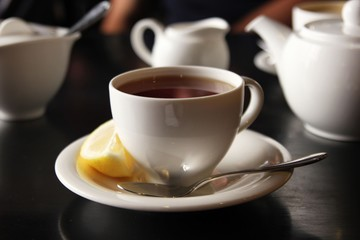 The cup of black tea with lemon